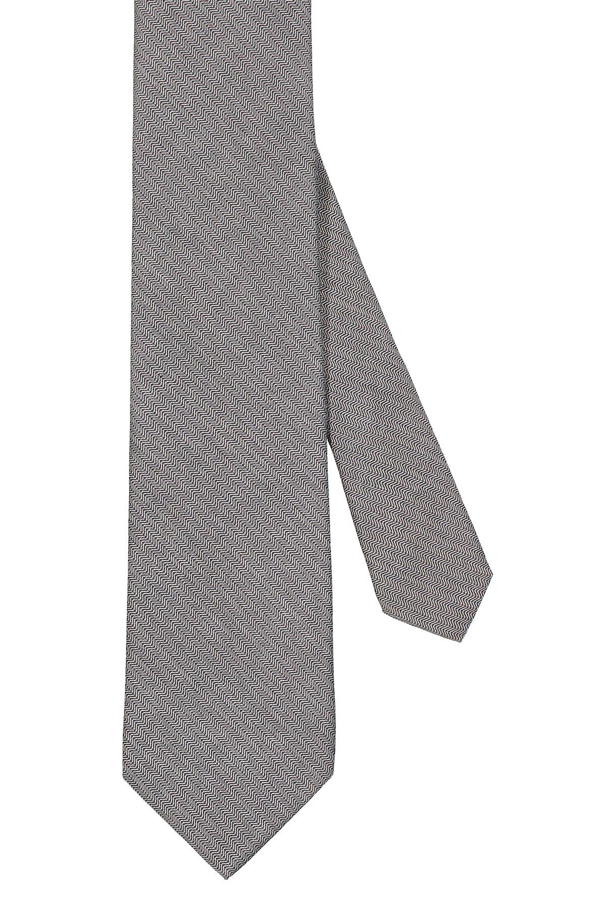 Corbata Calvin Klein, seda mezcla, color gris trama diagonal.