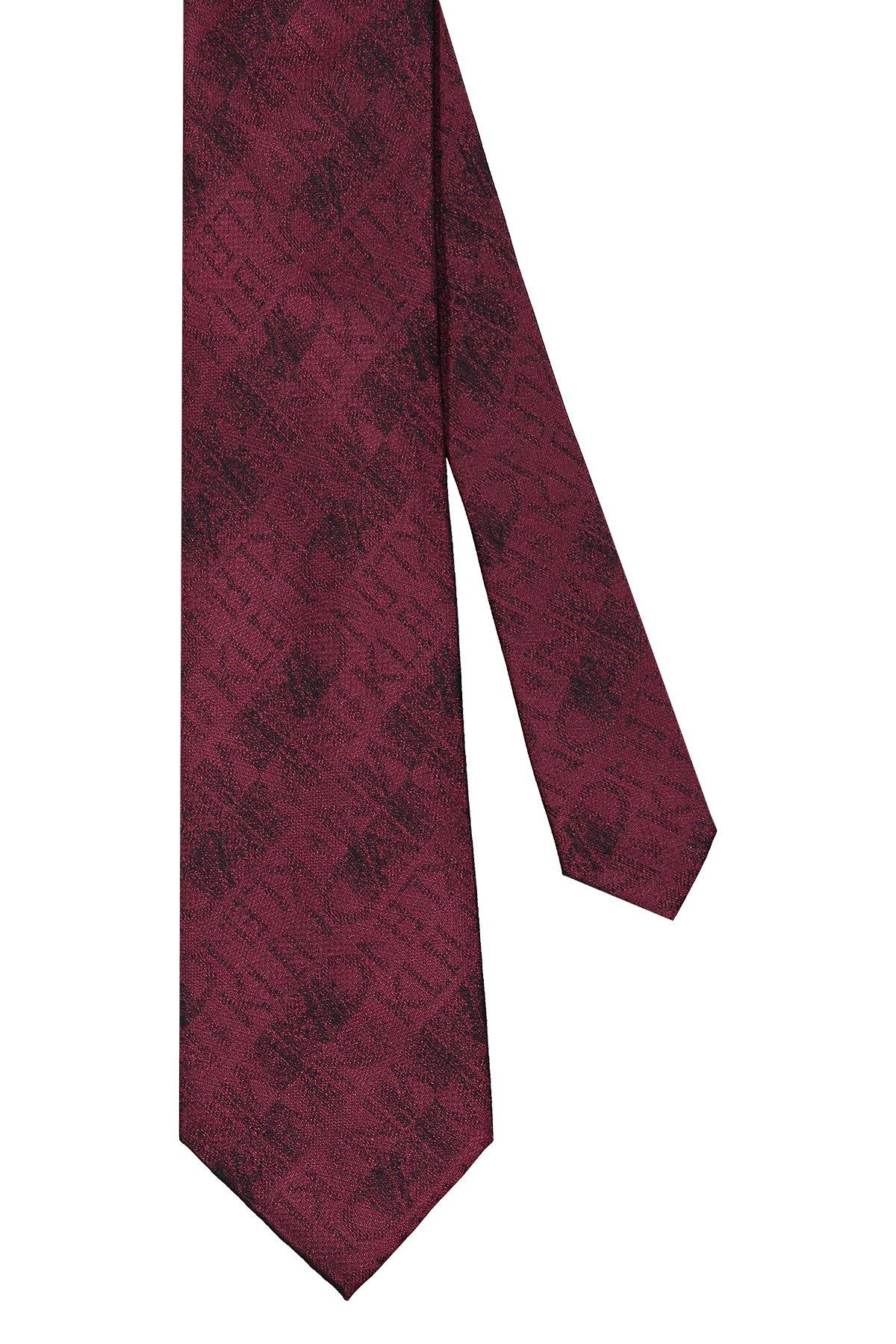 Corbata Calvin Klein, 100% seda, fondo bordo con bordado de marca.