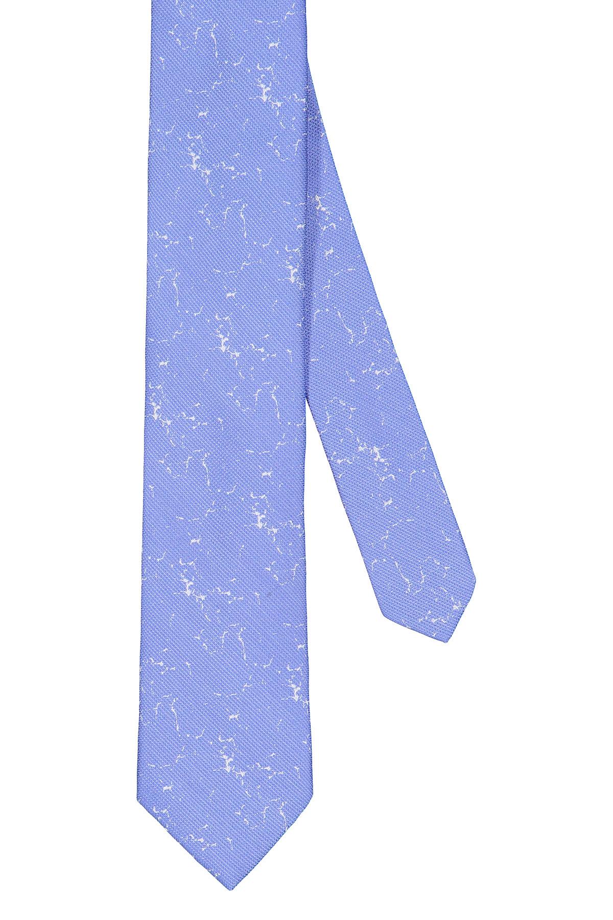 Corbata Calvin Klein, seda mezcla, celeste con fantasía en blanco.